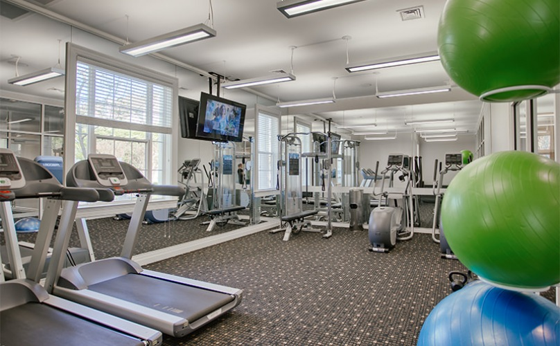 fitness center with large mirrors